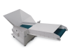 Optional output conveyor transports material out of the shredder and into an external waste bin. This increases capacity and decreases down time.