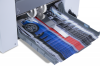 Outfeed stacking belt and rollers automatically adjust to paper size