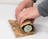 Perforated cardboard becomes a flexible netting, which is easy to wrap around items for shock-absorbing protection
